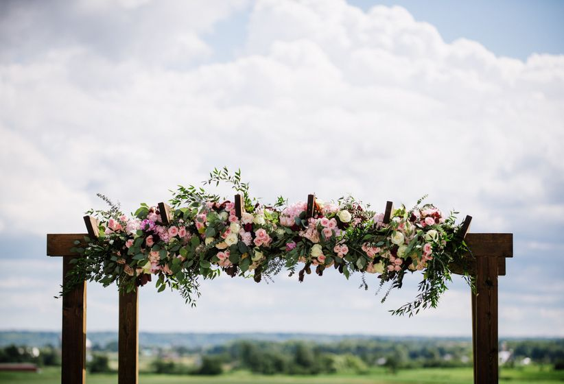 floral arbor at outdoor ceremony
