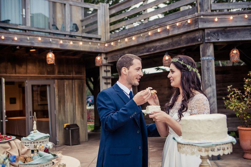 boho bride and groom cake cutting