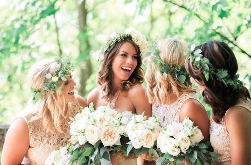 bride and bridesmaids with flower crowns and bouquets laughing brunch wedding West Virginia