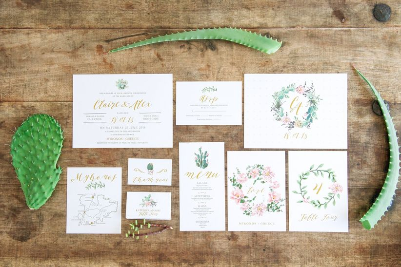Rustic floral invitation suite on wood background