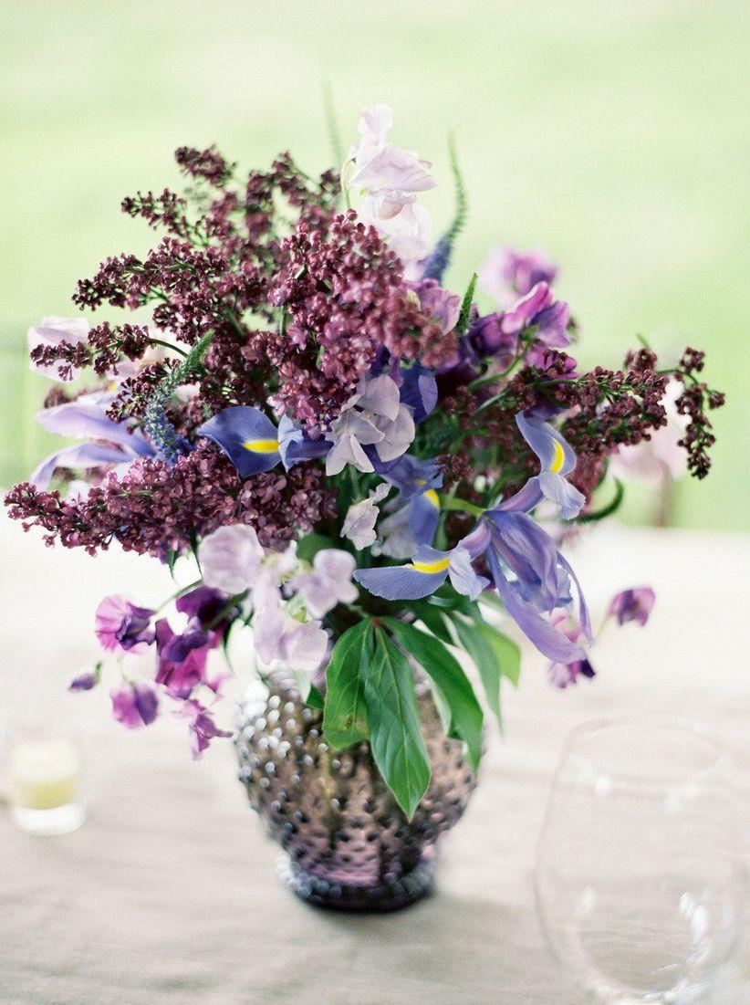 purple wedding centerpiece in purple clear vase