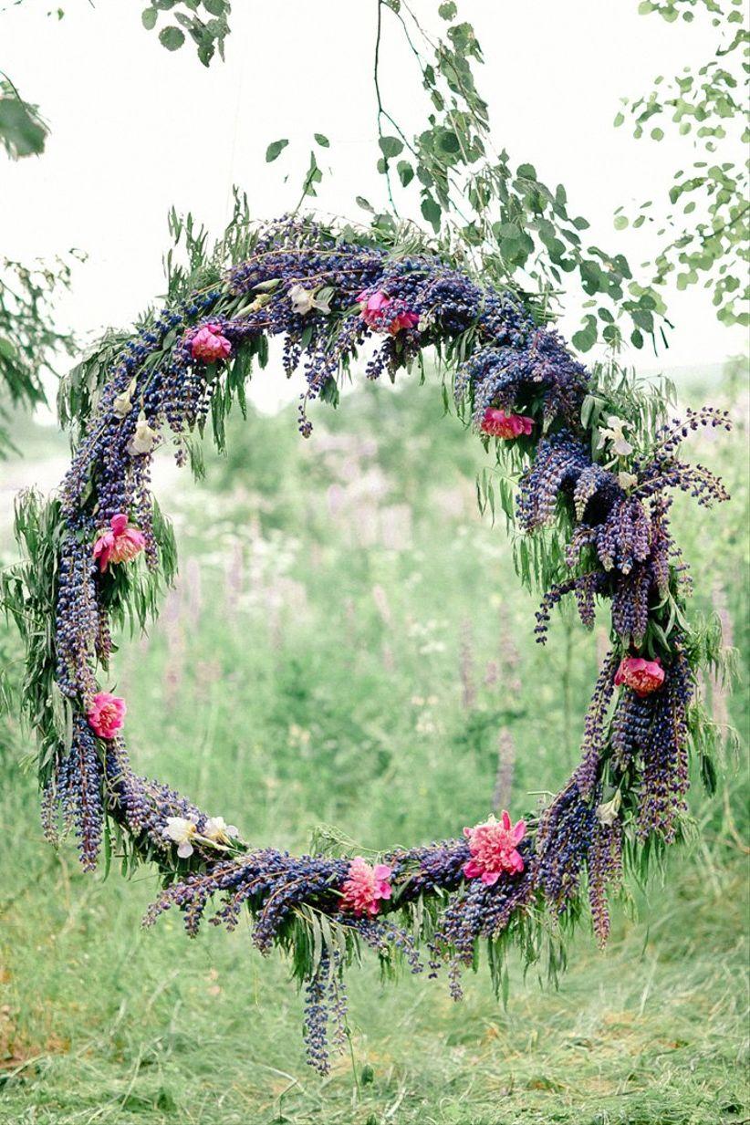 purple hanging wreath ceremony backdrop