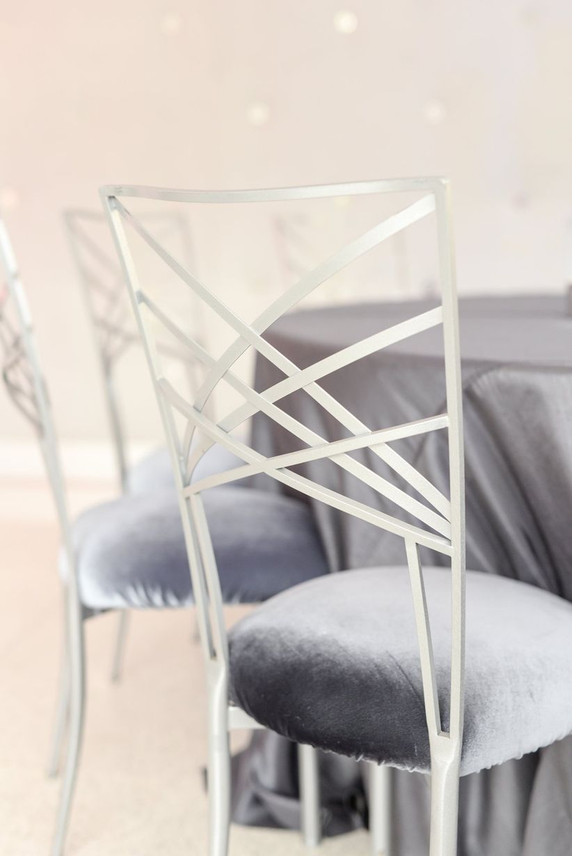silver chameleon chair with gray cushion