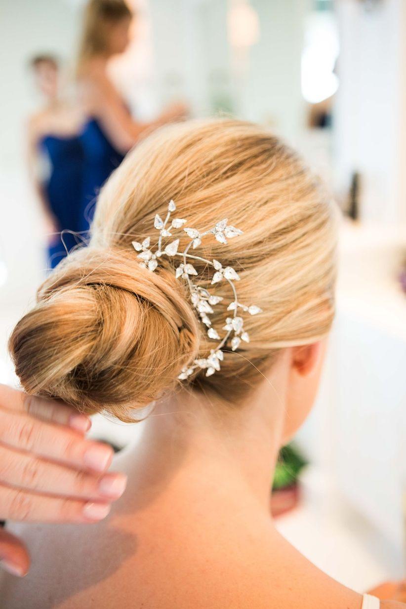 Bridesmaid chignon bun hairstyle floral hair clip