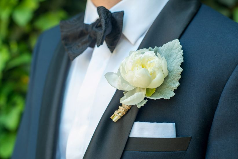 close up peony and dusty miller boutonniere