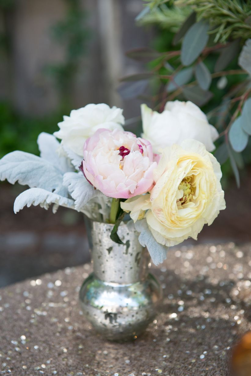 close up mercury glass vase with peonies and dusty miller