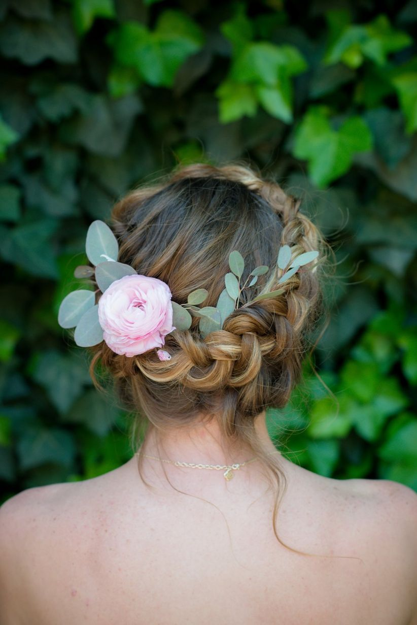 close up bridal updo halo braid flower accessory