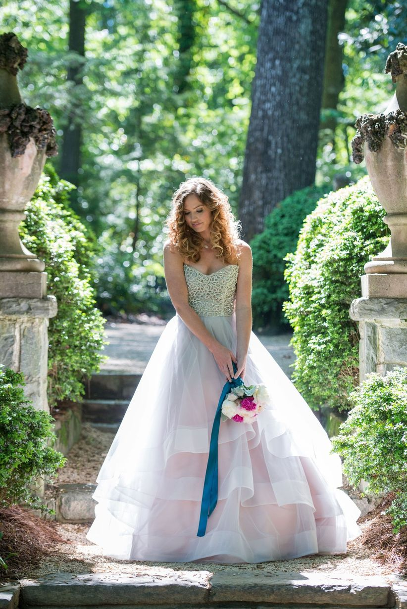 bride in hayley paige ball gown beaded bodice and tulle skirt hair in loose curls
