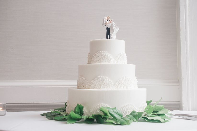 classic white wedding cake with topper