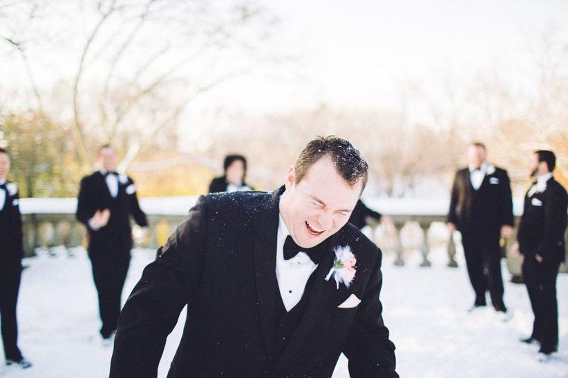 groom and groomsmen snow ball fight