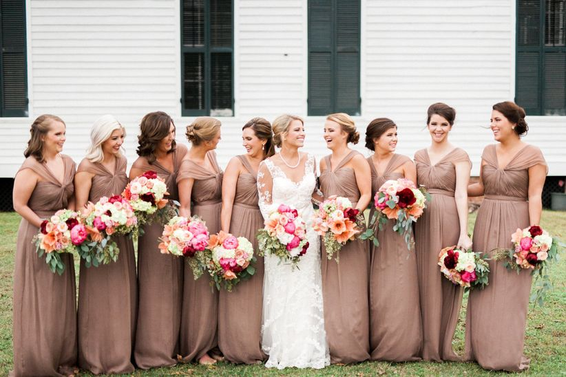 tan bridesmaid dresses pink bouquets