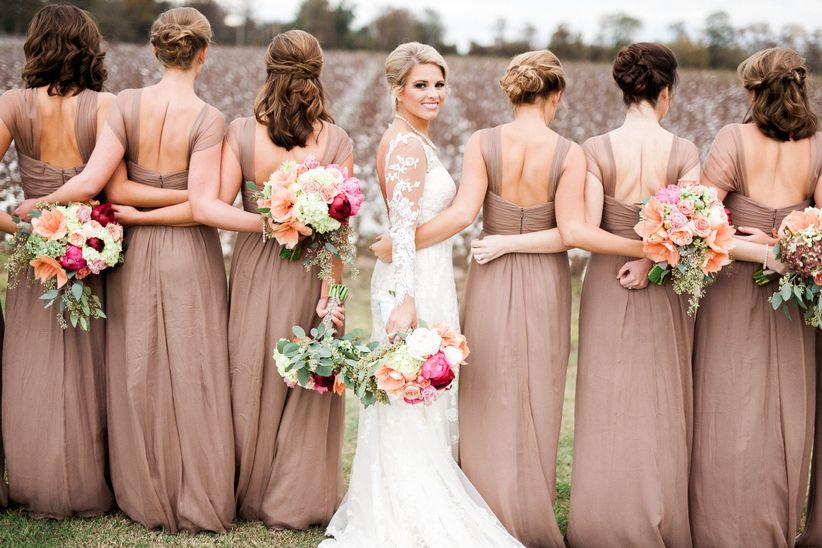 tan bridesmaid dresses with bright bouquets