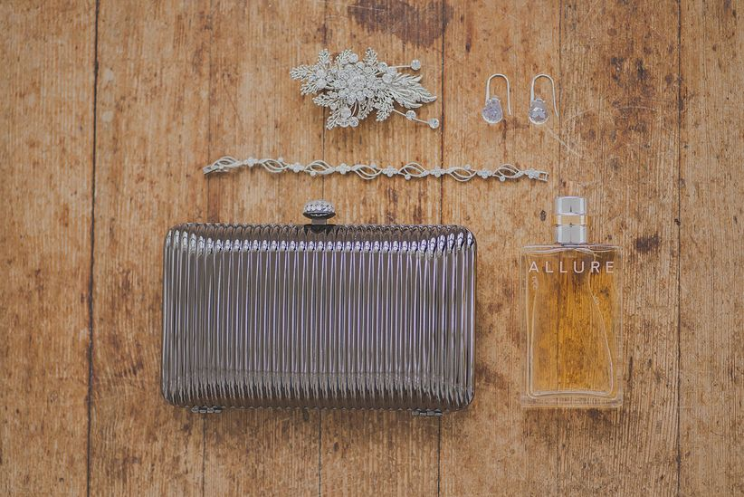 bride's accessories silver clutch bracelet earrings and hair clip