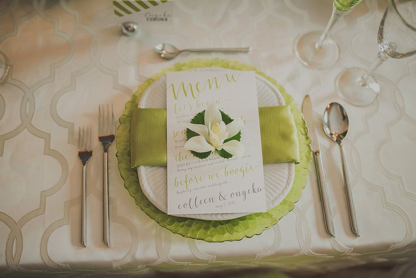 reception place setting green glass charger place napkin modern menu patterned table linens