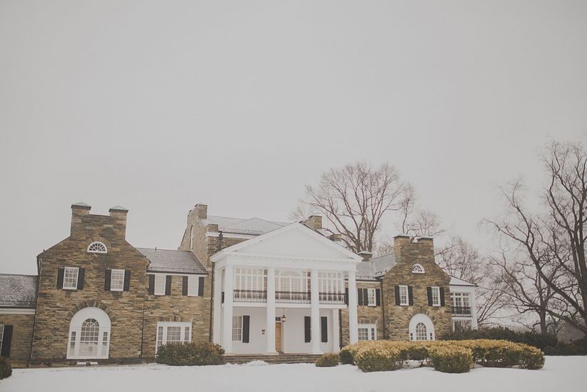 outdoor shot of historic mansion in the snow