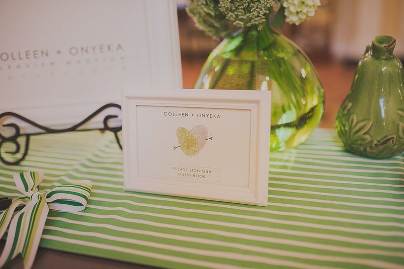 framed picture of couple's thumbprints used as non-traditional guestbook