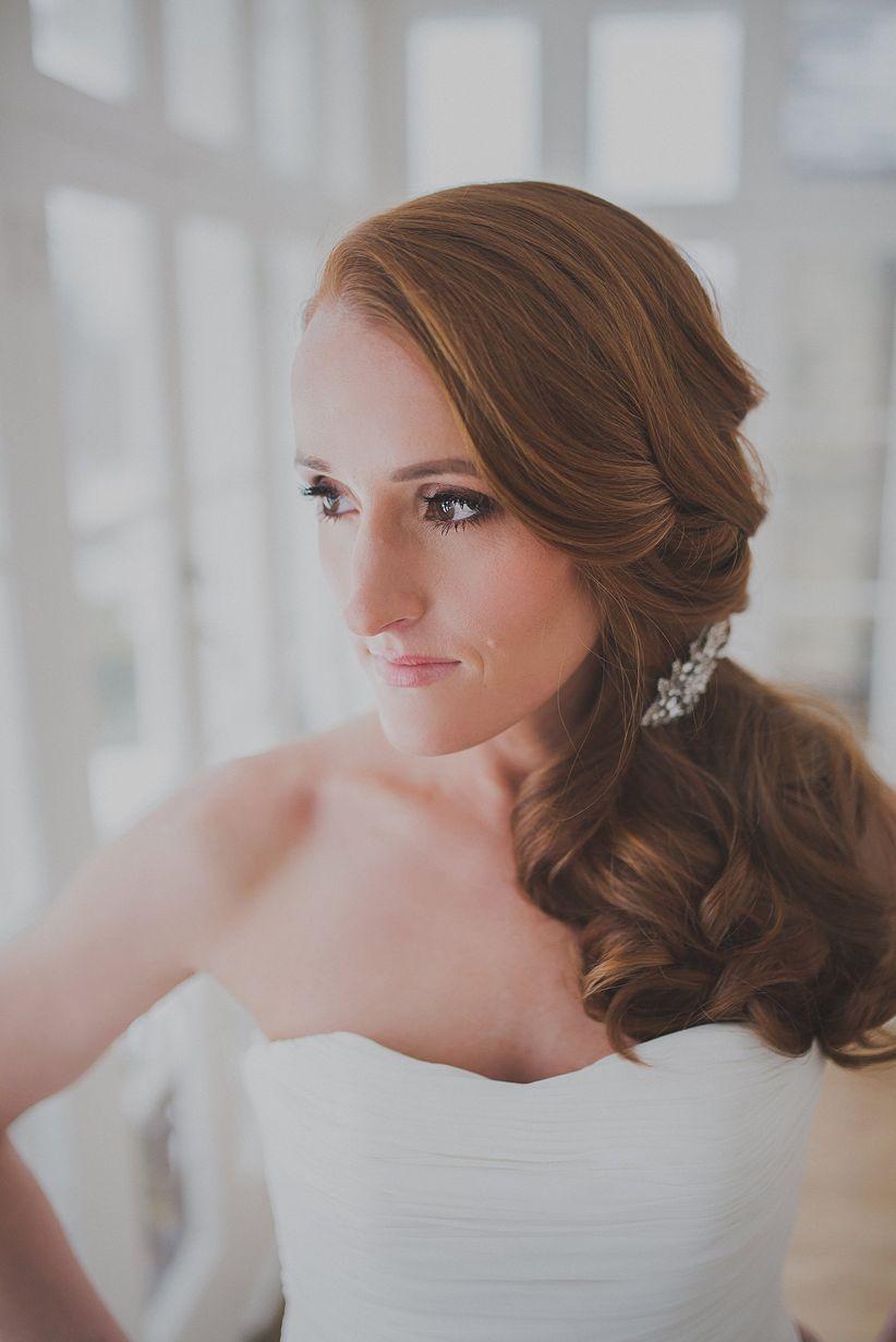 redheaded bride in strapless mermaid gown hair in side ponytail