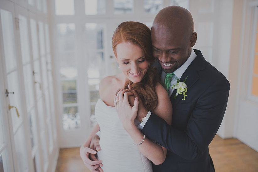 redheaded bride in strapless mermaid gown groom in navy suit in maryland mansion
