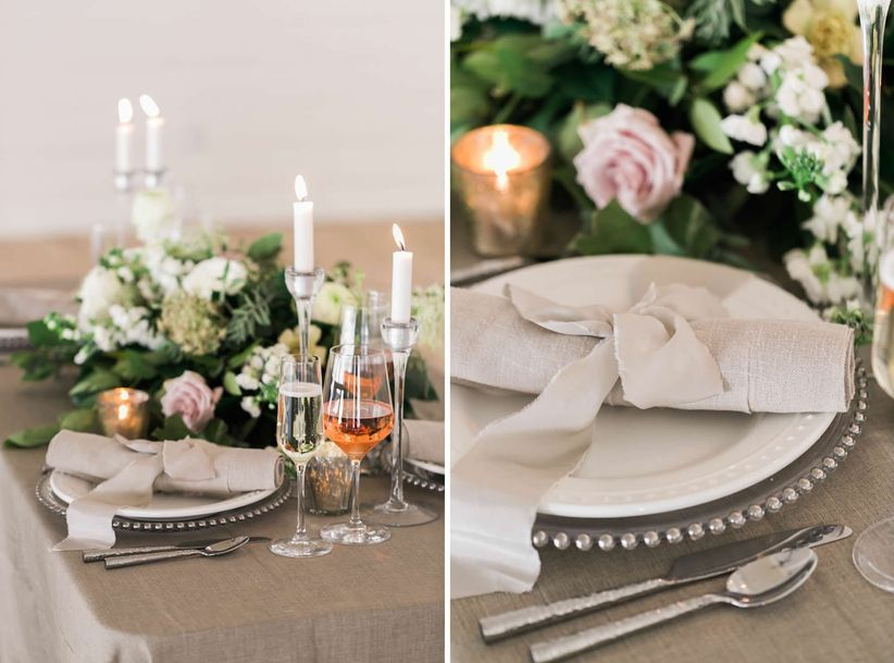 rustic wedding place setting with neutral table linens and ribbon napkin holders