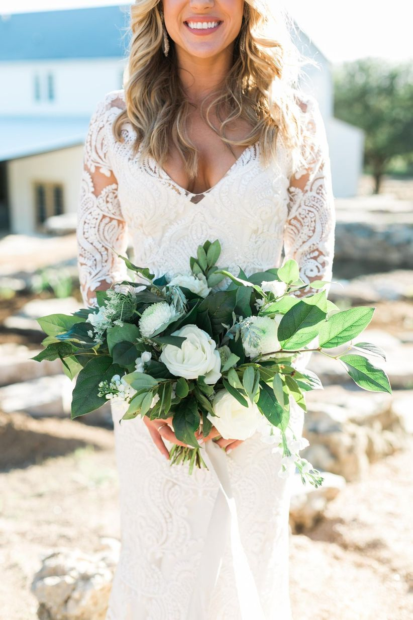 oversized bride bouquet with white flowers and loose greenery