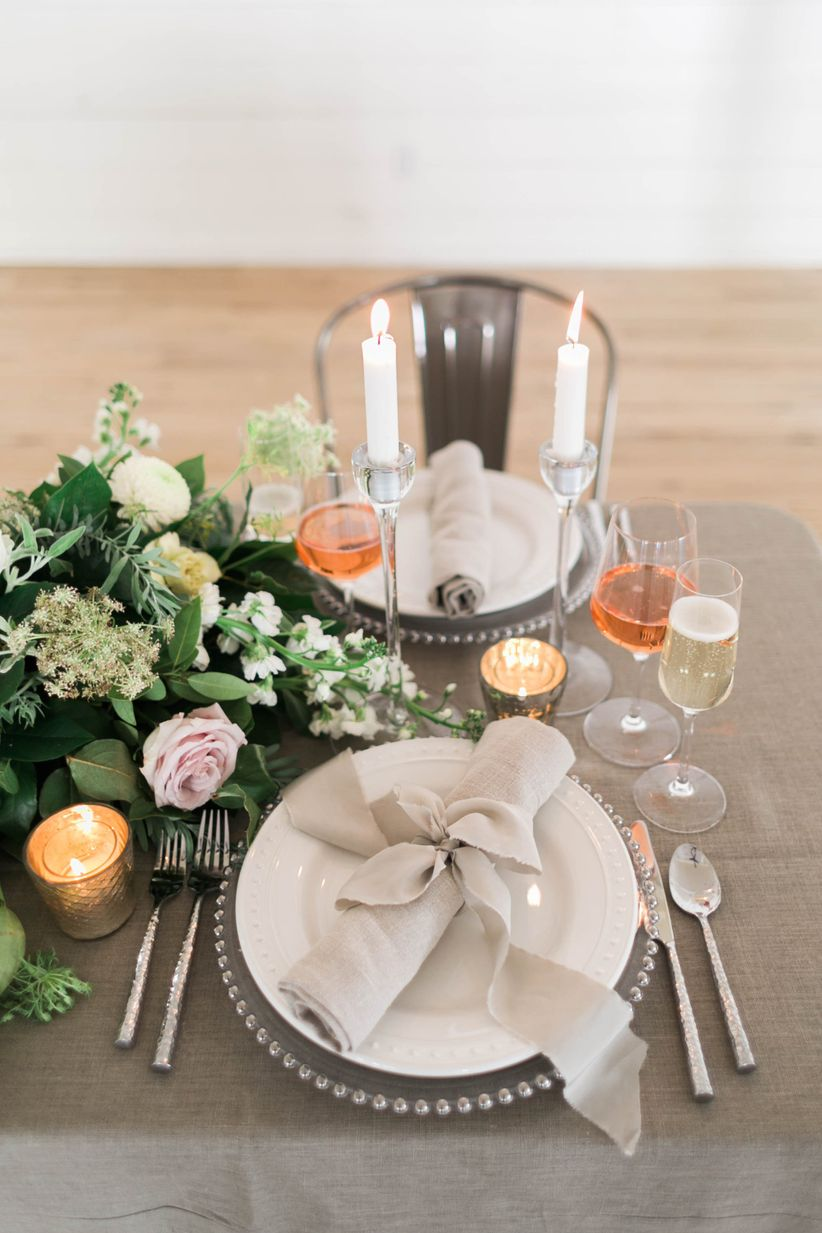 modern rustic wedding tablescape with greenery centerpiece and neutral linens
