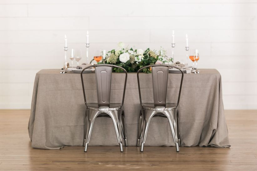 modern rustic wedding tablescape with farmhouse style decor and neutral linens