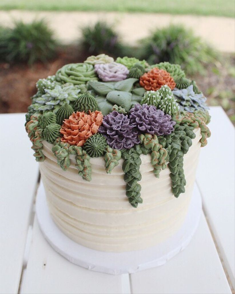 buttercream cake with icing shaped like succulents
