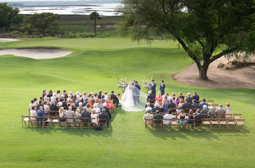 couple getting married on a golf course