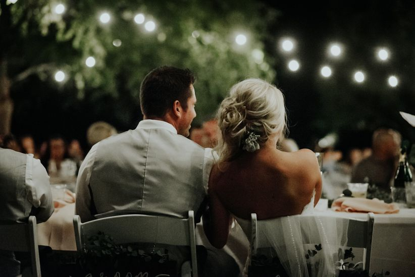 couple seated at reception