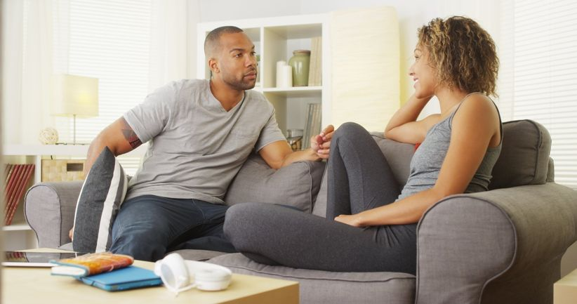 couple talking on couch together