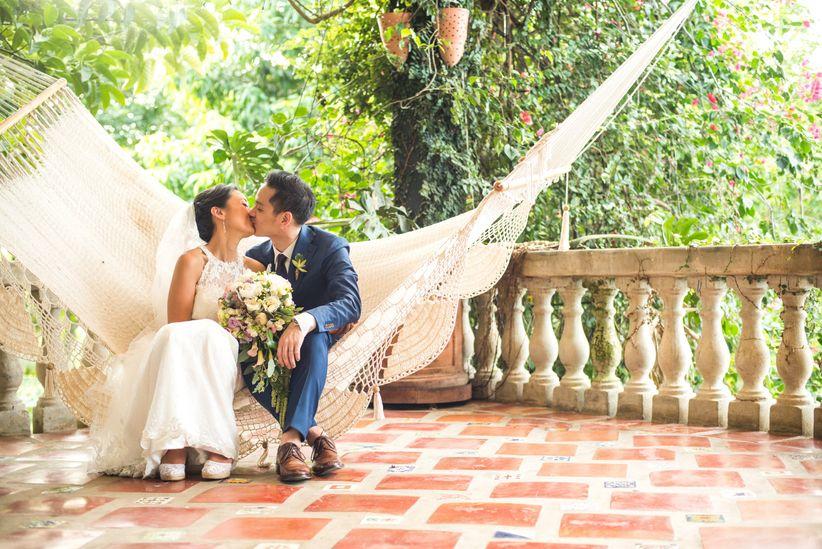 Cant afford a honeymoon dont panic weddingwire couple on hammock junglespirit Gallery