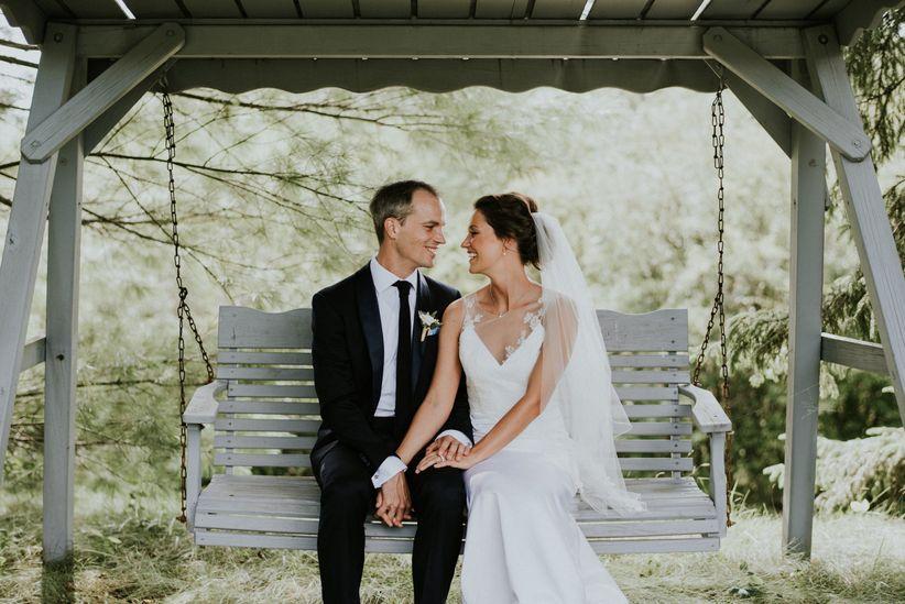 happy couple on swing
