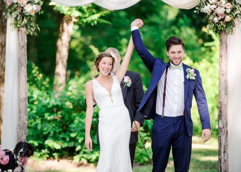 happy couple cheering recessional