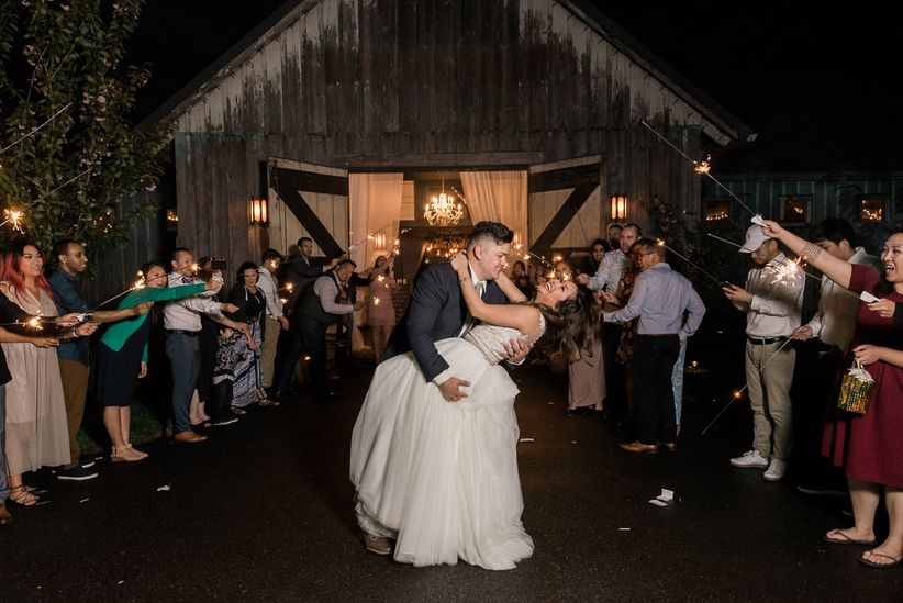 couple doing the dip during sparkler send off