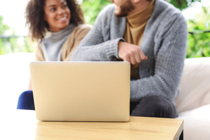 couple planning wedding on computer shutterstock