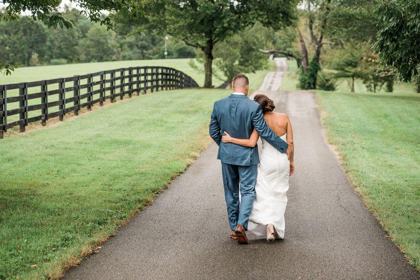 couple walking rustic wedding