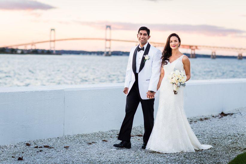 married couple walking on beach