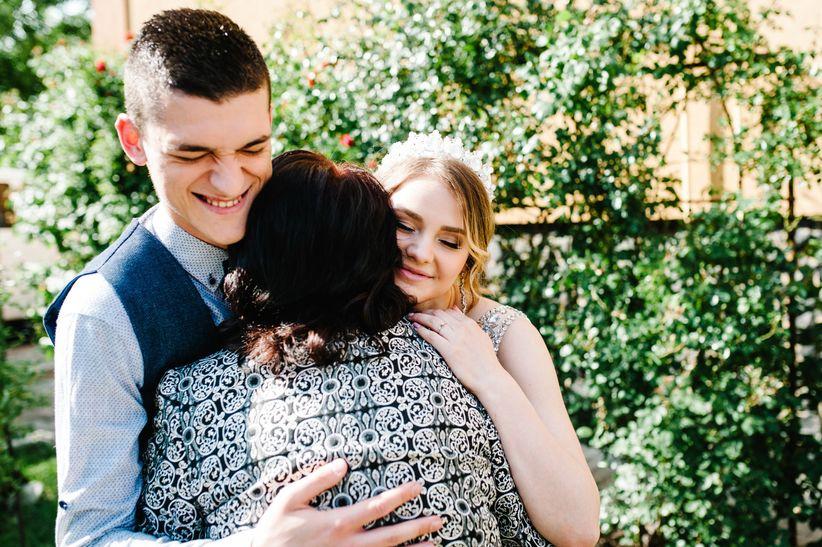 couple hugging mom