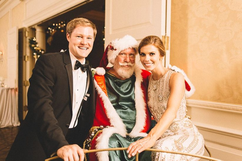 couple at wedding with santa claus
