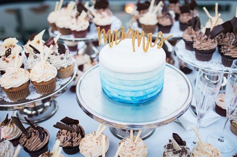 modern wedding cake with blue and white ombre buttercream frosting