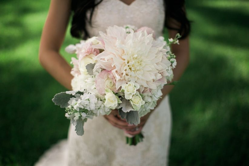 bride with cafe au lait dahlia bouquet