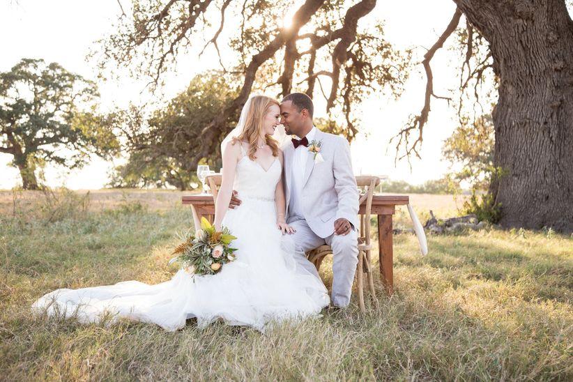 bride and groom kiss rustic outdoor venue dawn elizabeth studios
