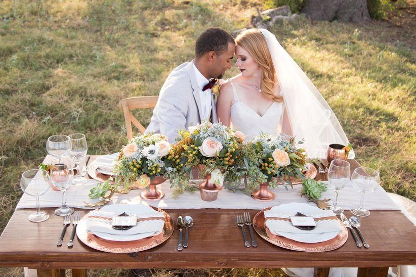 bride and groom pose at rustic tablescape - dawn elizabeth studios