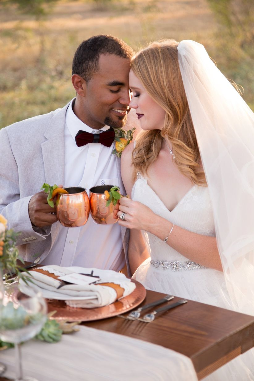 newlyweds toasting with moscow mules - dawn elizabeth studios