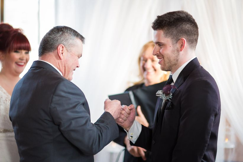 father of the bride with groom at ceremony