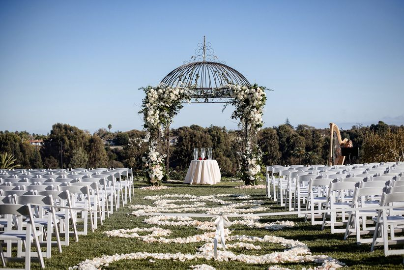 outdoor ceremony with petal lined aisle