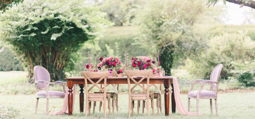 outdoor wedding tablescape with X-back chairs
