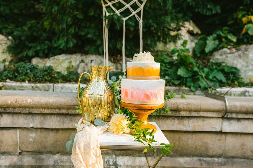 two-tiered fondant-frosted wedding cake