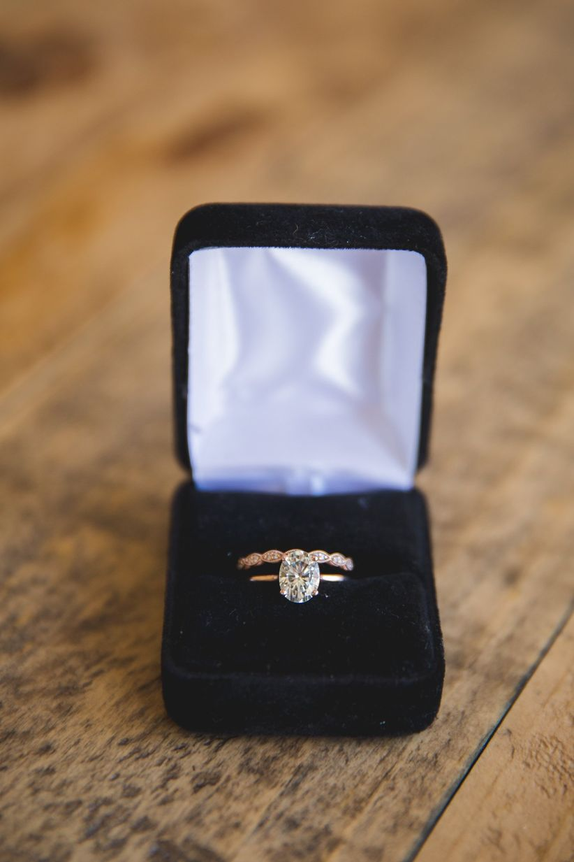 oval cut engagement ring with rose gold wedding band