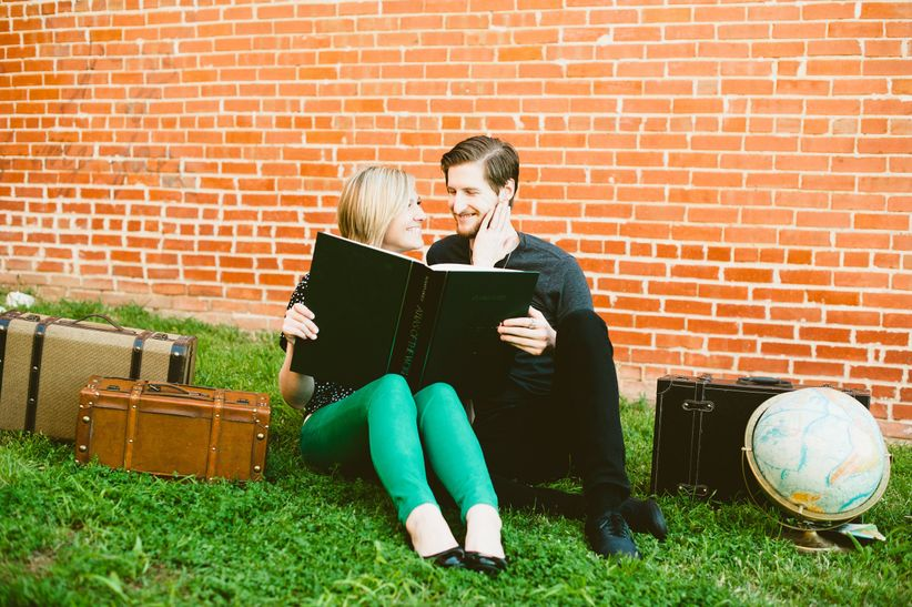 couple reading book engagement photo